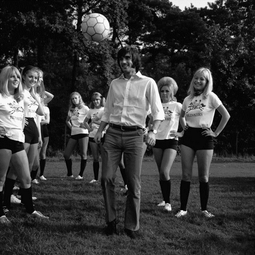 Manchester United footballer George Best shows girls of Blinkers United how to control a ball. Right is his fiancee Eva Haraldsted October 1969