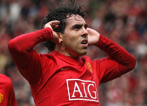 MANCHESTER, ENGLAND - MAY 10: Carlos Tevez of Manchester United celebrates scoring their second goal during the Barclays Premier League match between Manchester United and Manchester City at Old Trafford on May 10, 2009 in Manchester, England. (Photo by John Peters/Manchester United via Getty Images)