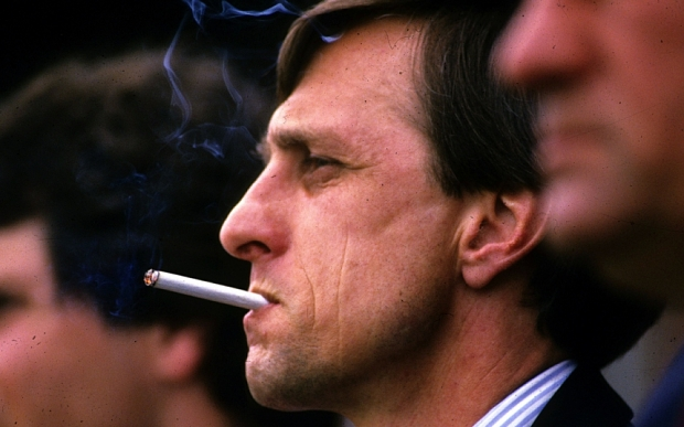 Mandatory Credit: Photo by Hollandse Hoogte/REX Shutterstock (5288276c) Johan Cruyff smoking a cigarette Johan Cruyff smoking on the touchline - 06 Dec 2006