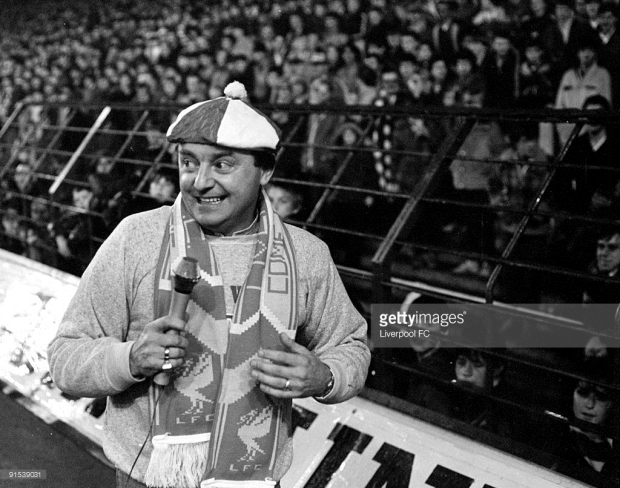 LIVERPOOL. ENGLAND. Gerry Marsden, of Gerry and the Pacemakers, enterains the fans at Anfield before thestart of a game. c1987-88