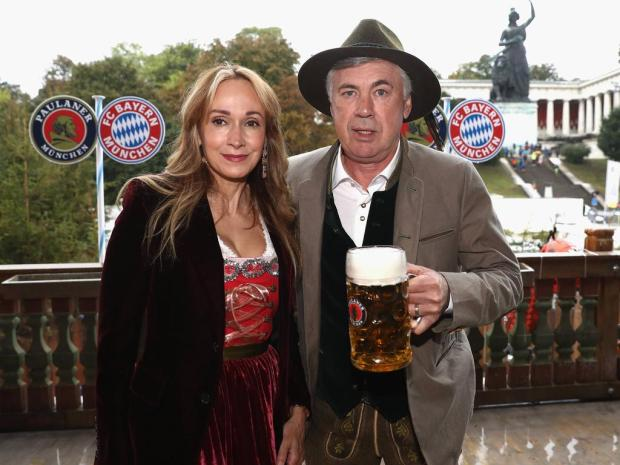 MUNICH GERMANY OCTOBER 02 Carlo Ancelotti head coach of FC Bayern Muenchen and his wife Mariann
